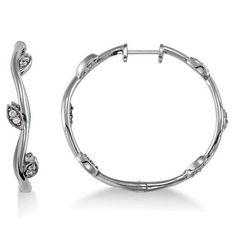 These diamond accented vine leaf loop earrings are crafted in beautiful white gold setting. The diamonds weigh approximately and are of G-H color and clarity. Diamond Hoop Earrings, Diamond Studs, Ring Earrings, Diamond Jewelry, Gold Jewelry, Mid Rings, Leaf Jewelry, Jewellery, Heart Pendant Necklace