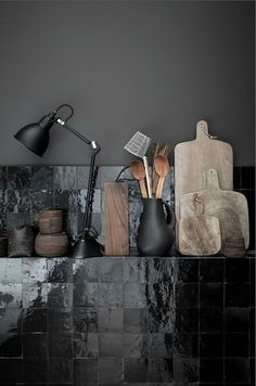 Beautiful black tiles against black wall in a kitchen really sets off the wooden tools. Someone speculated these are Zellige tiles. Kitchen Interior, Interior And Exterior, Turbulence Deco, Dark Walls, Dark Interiors, Black Kitchens, Kitchen Black Tiles, Kitchen Grey, Natural Kitchen