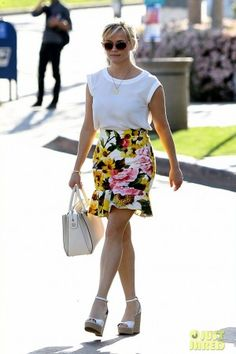 Reese Witherspoon wearing Thierry Lasry Tipsy Sunglasses, the Row Satchel 12 Tote Bag, Tabitha Simmons Harp Perforated Leather Wedge Sandals, Dolce & Gabbana Floral-Print Textured Stretch-Cotton Skirt and J.Crew Sleeveless Drapey Top