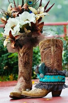 Country wedding photo. Her boots, garter, bouquet and rings.