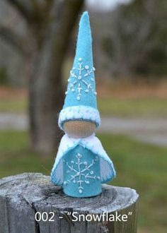 """Snowflake"" -- peg gnome handmade from wooden peg, wool felt, and cotton floss."