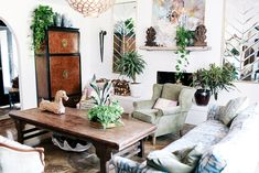 An eclectic living space with thrift-store finds and lots of indoor plants