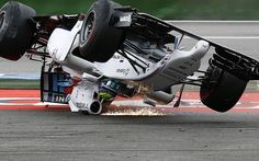 2b283114a262 ... One driver Felipe Massa of Brazil crashes with his car in the first  corner after the start of the German Grand Prix at the Hockenheim racing  circuit