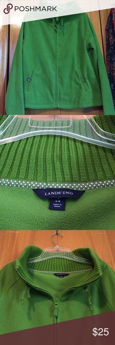 LANDS' END   Sweater Super soft sweater by LANDS' END. Lovely shade of green - true color captured on photos 2 & 3. Women's size 6-8. Front has zipper and two button pockets with drawstring at neckline. Inside has two pockets. All buttons present and includes extra button! Lands' End Sweaters