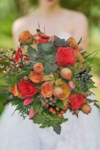 Succulent wedding bouquet. vintage style,  corals and peaches bridal bouquet.There she glows by Enchanted Florist in Taos New Mexico