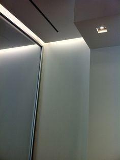 Elegant indirect lighting combined with sleek design, showroom in Belgium _
