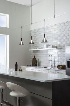 "The Mezz pendant light by Tech Lighting is simply handsome featuring a sleek modern canonical shape and tipped sabre. At its core sits a cylindrical acrylic diffuser. The Mezz scales at 7"" in height and 3.5"" in width making it ideal for kitchen island task lighting. The Mezz is available in two on trend color options, Clear and Transparent Smoke and two sleek finishes, Satin Nickle and Matte Black. A high powered integrated LED lamp provides ample amounts of light onto surfaces below."