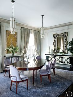 Dining room: 1940s Baguès pendant lights, a French Art Deco wall plaque, and a '40s-style Venetian mirror (all from Newel)