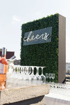 Let your bar glow with a neon sign. This modern version (planned by Big City Bride) was set on a translucent slab and hung from a boxwood wall.