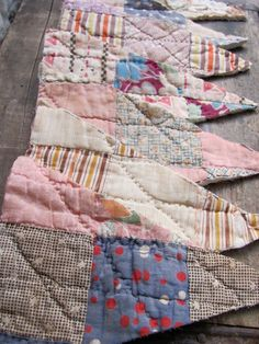 vintage Depression Era quilt scraps bunting flags ~ many old quilts are in deplorable condition, so perhaps a good way to give them a new lease on life. Baby Bunting, Bunting Garland, Bunting Banner, Banners, Buntings, Bunting Ideas, Old Quilts, Antique Quilts, Vintage Quilts