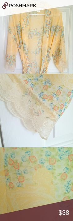Floral and lace kimono Gorgeous floral kimono in soft yellow and lace detail on sleeve cuffs. Light and aerie, perfect for hot summer days! Perfect, new condition! S/M size. Flora Intimates & Sleepwear Robes