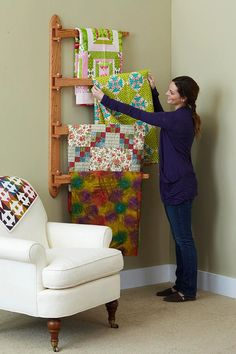 A hanging quilt rack that holds four quilts! Great space saver! Woodworks by Brooks