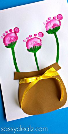 Use little feet for this flower pot footprint craft for kids.