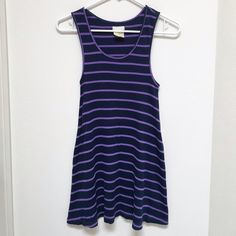 Free People Striped Tunic Tank NWOT Tank measures 30 inches in length from shoulder to hem. It's ribbed with navy and purple stripes and has a racerback. Was too big, now too small 😩 Never worn! Marked Medium but would best fit a Small ✨ Free People Tops Tank Tops