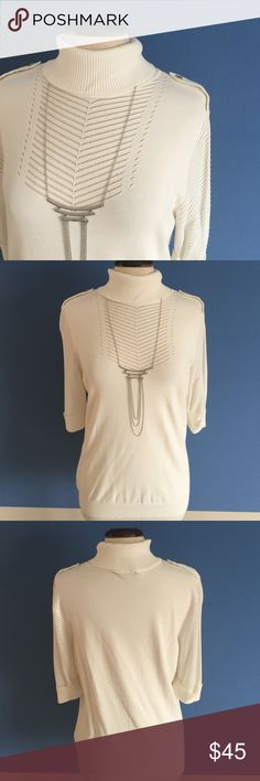 WHBM Cream Sweater When you walk into the room with this sweater, time will stop!  The arrow designated on the front is see through.  The sleeves are like a sweater mesh.  Pair with a necklace, black leggings and boots.  Hey girl!  😀. **Necklace also available in my closet. **. Material:  73% Rayon/2% Nylon. White House Black Market Sweaters Cowl & Turtlenecks