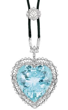 Belle Epoque Platinum, Aquamarine and Diamond Pendant-Brooch with Black Cord Necklace  Suspending one heart-shaped aquamarine approximately 40.00 cts., within a delicate filigree frame set with single-cut diamonds, completed by a cord necklace, accented by a diamond-set slide, circa 1910.
