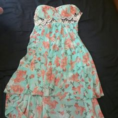 Cute cutout strapless dress Length dress with cut out, floral design.. so cute, worn once to a bridal shower Dresses Strapless