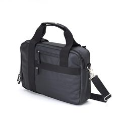 "QWSTION - OFFICE BAG - ORGANIC JET BLACK - If you travel for work and need lots of flexibility, this bag is for you. The Office Bag offers direct access to a laptop compartment with protective Neoprene padding which fits up to a 17"" MacBookPro®. The main section opens widely for your documents and workbooks. The unique One-for-Two-System® transforms the Office Bag into a backpack for all city cruisers, cyclists and office nomads. #questionthenorm"