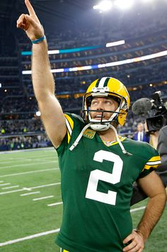 Green Bay Packers kicker Mason Crosby soaks in the moment after his winning field goal with three seconds left in the game as the Green Bay Packers...
