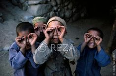 """Afghanistan. 1985.   I arrived in a village. The children rushed up to me and surrounded me, and they began to imitate me, playing at being photographers. Their laughter, their warmth, and their spontaneous friendliness erased all of the fatigue and discouragement I'd felt. It reminded me of a beautiful truth I had read in James Rumford's book Traveling Man: The Journey of Ibn Battuta, 1325- 1354: """"Traveling — it offers you a hundred roads to adventure, and gives your heart wings!""""."""