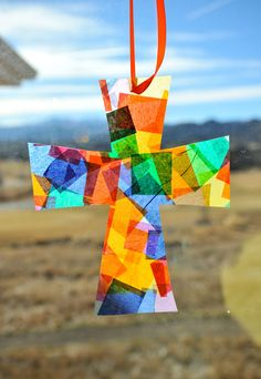 A cross sun catcher is a perfect craft for any time of the liturgical year. It is especially a good  craft project for Easter. It is perfect for any skill level.