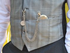 pocket watch & Albert chain (with spring ring), worn from vest buttonhole to vest pocket, featuring a coin fob on the drop