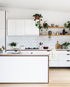 "80 Likes, 1 Comments - SUNDAY LIFE (@sunday.life) on Instagram: ""Gorgeous white kitchen. Source: Pinterest #white #tiles #wood #plants #green #kitchen…"""