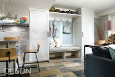 The goal of this basement renovation was to create a space for a young, active family and lots of their friends.  The entrance opens to the outside, so we created a mudroom with finishes and storage that would withstand wet shoes, coats, hats and sports equipment. #candiceolson