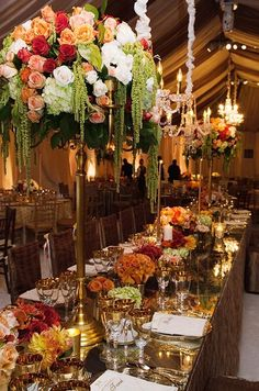 Gilded gold tablescape with floral centerpieces of varying height #wedding #gold #blacktie #reception #centerpiece