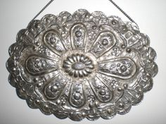 "This is a sterling silver carved mirror from Turkey. All the backs are intricately carved so they could be turned face down- in Islam the ""mirror"" face could not reflect an image to the room."