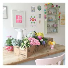 A lovely box full of Spring flowers, pink roses, hydrangeas, wax flower, ranunculus and hyacinths