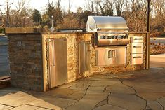 Outdoor Kitchen with drawers, refrigerator, sink, double doors & side burner