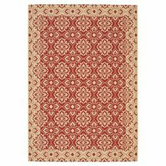 Indoor/outdoor rug with a red and creme floral lattice motif.  Product: RugConstruction Material: PolypropyleneColor: Creme and redFeatures: Machine madeSuitable for indoor and outdoor use Note: Please be aware that actual colors may vary from those shown on your screen. Accent rugs may also not show the entire pattern that the corresponding area rugs have.Cleaning and Care: Professional cleaning recommended