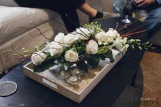 A beautiful centerpiece idea. Private party floral ideas, roses and orchids, white and green floral arrangement.