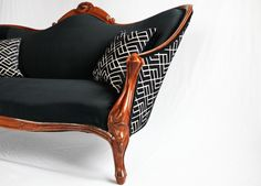 """so fancy!  """"An antique Victorian sofa circa 1890, reupholstered in a dark navy velvet from Herman Miller. The reverse side has been reupholstered in a navy patterned fabric. The throw pillows have visible gold zippers and match the contrasting front and back of the sofa. The hand carved frame has been fully restored to its original finish."""""""