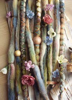 Removable Wool Tie-dye dreads by Purple Finch! Set of 10 total Hair Extensions  Set Includes: 7 Unwrapped wool Tie-dyed dreadlocks 3 x-cross wrapped tie-dye dreadlocks 2 Wood Bead 12 Flower