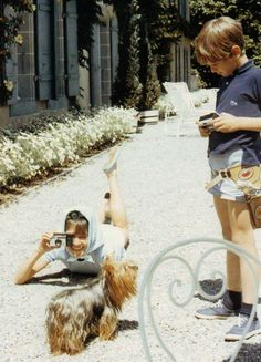 """The actress Audrey Hepburn photographed with her son Sean and Assam of Assam (her second Yorkshire Terrier) by Mel Ferrer at her famous residence called of """"La Paisible"""" in Tolochenaz (Switzerland), in May 1967."""