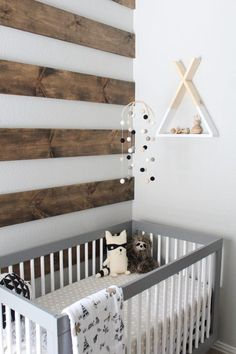 Rustic nursery decor // baby boys room with wooden panels