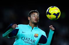 Neymar of FC Barcelona juggles the ball during the warm up prior to the La Liga match between FC Barcelona and RCD Espanyol at Camp Nou on November 1, 2013 in Barcelona, Catalonia.