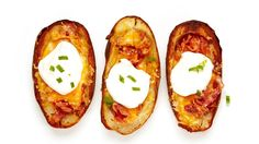 These Lightened Up Crispy Potato Skins are baked (not fried!) to crisp perfection and mounded with crunchy turkey bacon and melted cheese.
