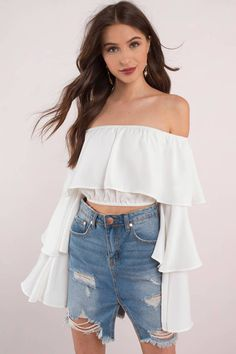 Add the Show Off Shoulder Ruffled Blouse to your wardrobe. Featuring an off shoulder neckline and three tiers with bell sleeves. Pair with a denim ski - Fast & Free Shipping For All Orders!
