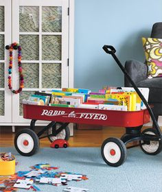 Do you have a wagon that's permanently parked? Use it indoors as a stylish bookmobile, says New York City organizer Chip Cordelli. Store board books spines up so kids can easily see and select their stories.