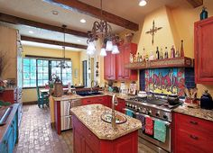 Eclectic kitchen with red cabinets and yellow walls. Southwest Kitchen, Mediterranean Kitchen, Southwestern Home, Eclectic Kitchen, Southwest Decor, Red Kitchen, Kitchen Colors, Kitchen Ideas, Happy Kitchen