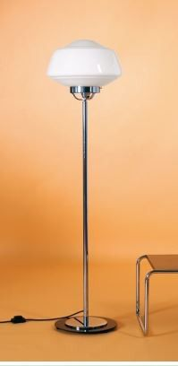 "This art deco floor lamp was designed in 1930 by an anonymous American designer. It features a beautiful polished chrome frame and a shade in opal glass. Made in Italy. Dimensions: Height 55 1/4"" Diam"