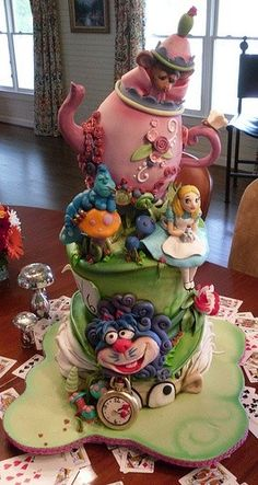``I love this one as a wedding cake, but I don't want Alice's face visible. Too much room to mess up the whole cake on tiny details. I like where her legs are sticking out of the rabbit hole better.