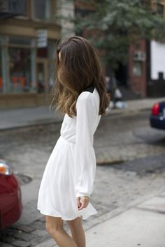 the sweetest little white dress with long sleeves and a flirty hemline
