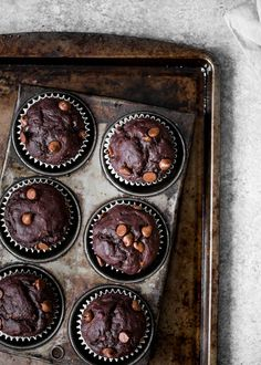 Healthy double chocolate banana muffins made with whole grains and greek yogurt. No added sugar and healthy enough to enjoy for breakfast!