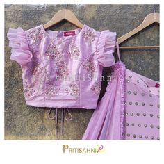 Now frills attached.Love this absolutely stunning combination of florals and frills with our favourite colour of the season - Llilac.For more information Whatsapp on 27 May 2018 Kids Blouse Designs, Sari Blouse Designs, Designer Blouse Patterns, Kurta Designs, Blouse Styles, Designer Dresses, Blouse Models, Sleeve Designs, Clothes For Women