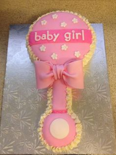 Baby Rattle Cake for girl baby shower by Sweet Treat Designs. Vanilla cake with vanilla custard filling and buttercream  www.sweettreatdesigns.com