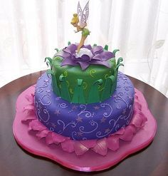 Tinker Bell Cake! I would still be thrilled at the age of 26 to have this for my bday :)